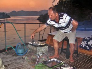 BBQ Turkish yacht grilling fish on a gulet cruise