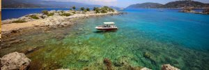 The Blue Cruise in Turkey small baot in a cove